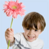 Image of child holding a flower