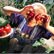 Image of child holding fruit
