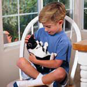 Image of child holding a pet