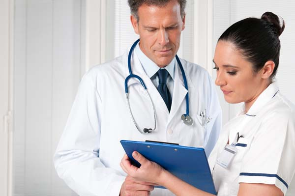 Doctor and nurse examining charts