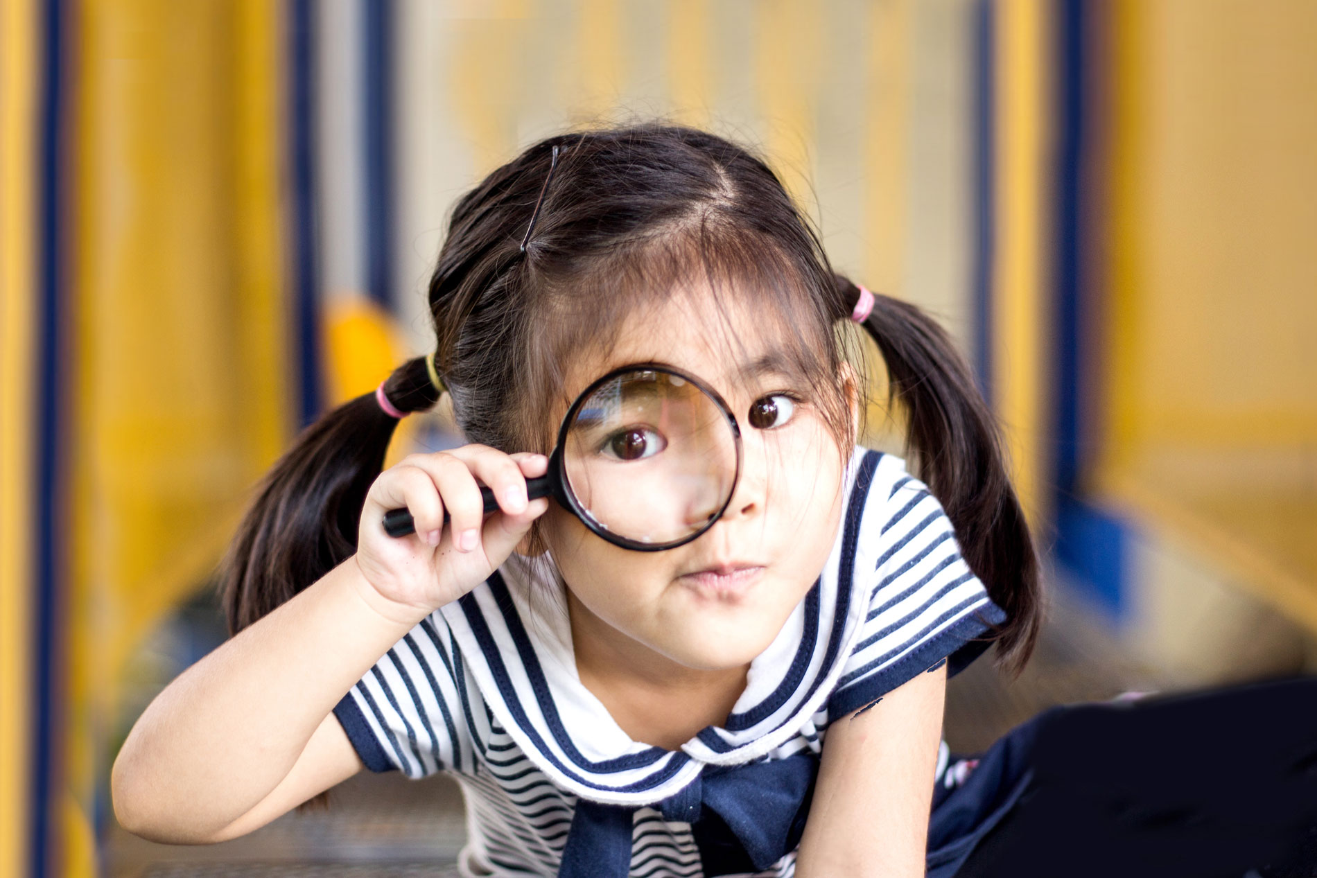 photo of girl with magnifying glass