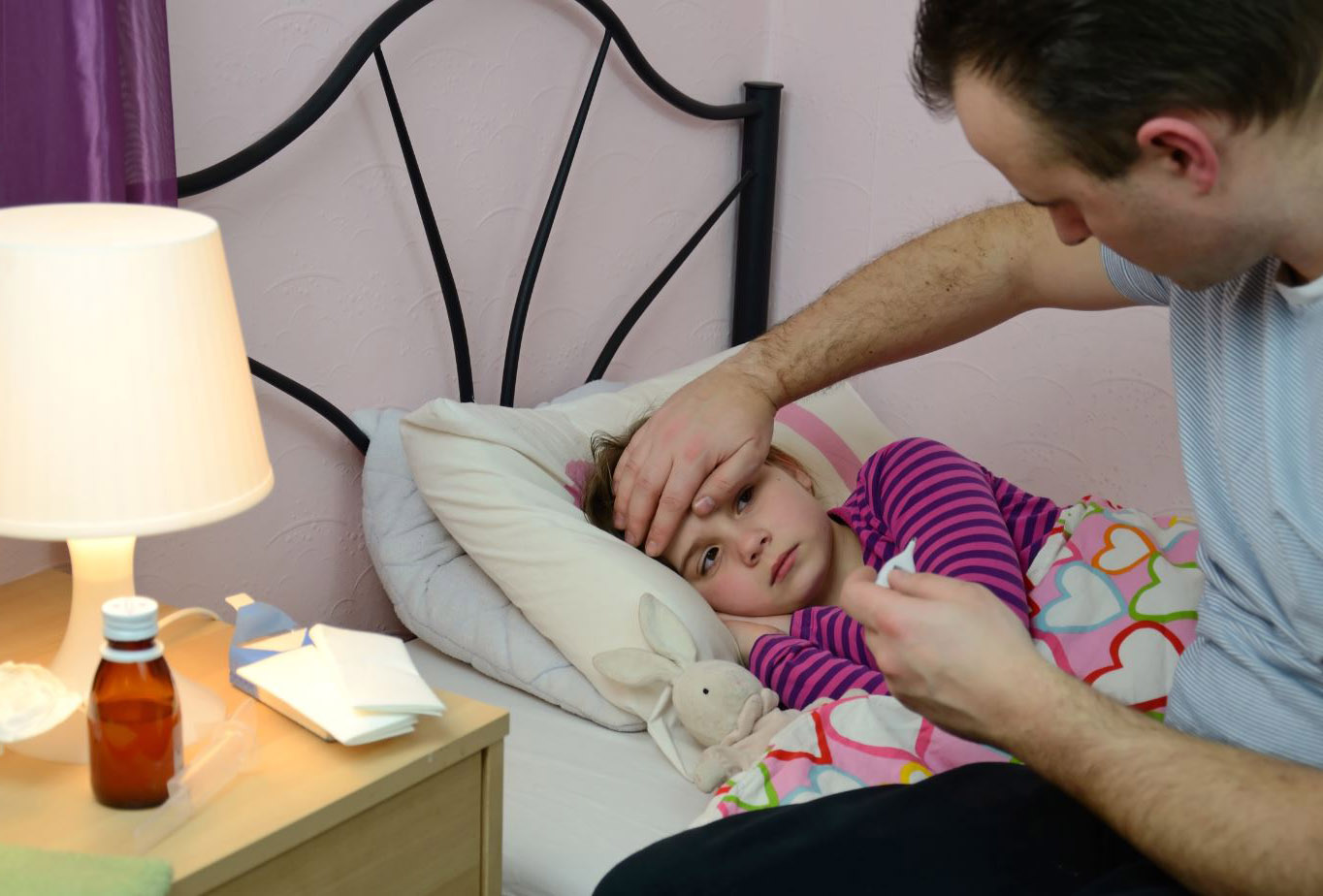 father tends to sick child